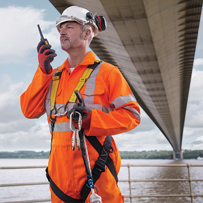 Bridge worker on walkie talkie