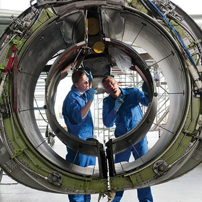 Engineers inspecting turbine