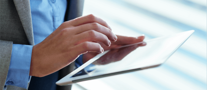 Man with tablet - procurement for GovCon